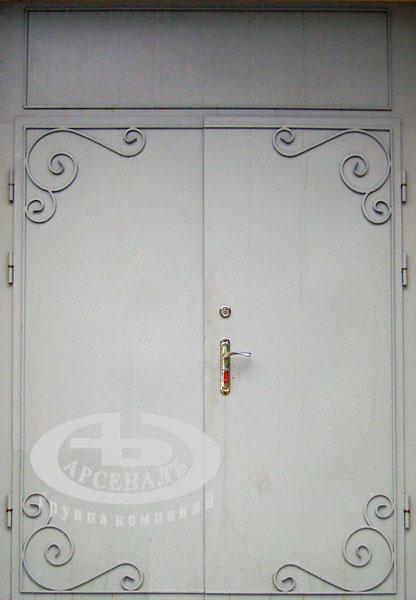Дверь с элегантной кованой решеткой позволит совместить красоту и надежность, придаст Вашему дому или офису...